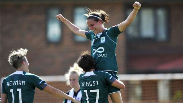 Nicole Sykes is congratulated after scoring a goal against Newcastle.