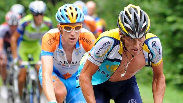 Lance Armstrong (right) climbs with Bradley Wiggins and during stage 17 of the 2009 Tour de France from ...