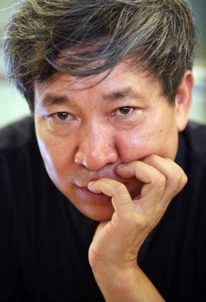 Chinese author Yan Lianke who wrote the banned book <i>Serve the People</i>.