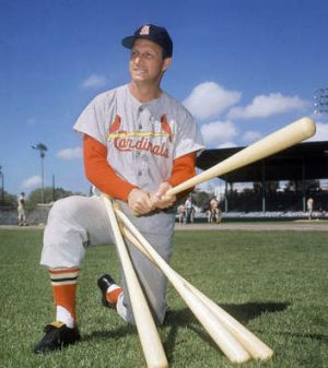 Stan Musial visits his former teammates at the St. Louis Cardinals spring training baseball camp in Florida in 1964. (AP ...