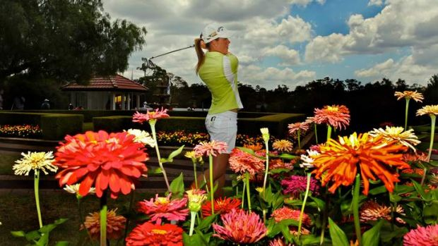 In bloom ... Stacey Keating on the practice range at Oatlands. The Victorian was tied for the lead in the NSW NSW Womens ...