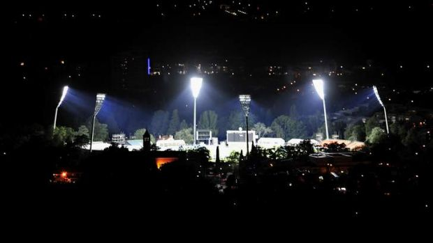 The lights at Manuka oval are turned on for the first time.