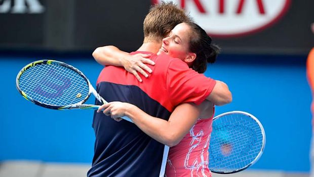 Through ... Jarmila Gajdosova embraces Matthew Ebden after the pair booked their place in the mixed doubles final with a ...