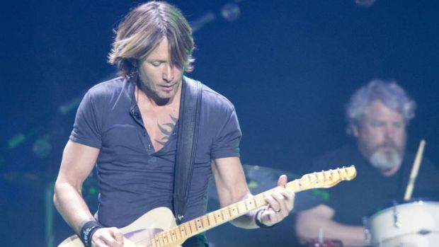 Caboolture boy turned country-rock crossover star Keith Urban delivered generority - and quite a few guitar solos-  to a ...