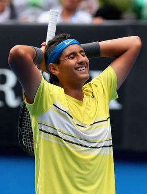 Kyrgios reacts after serving an ace on championship point.
