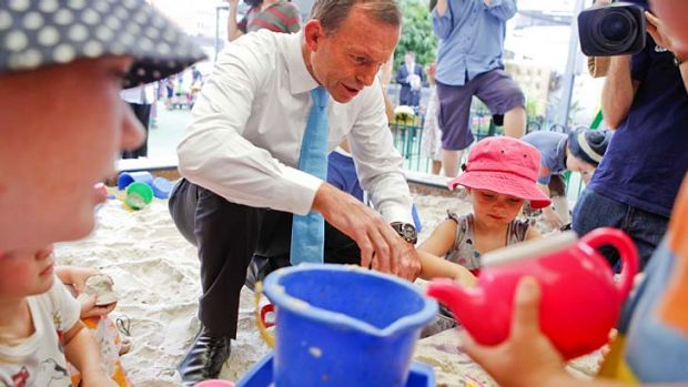 Yes, he can ... Tony Abbott shows his softer side at a Brisbane childcare centre last week.