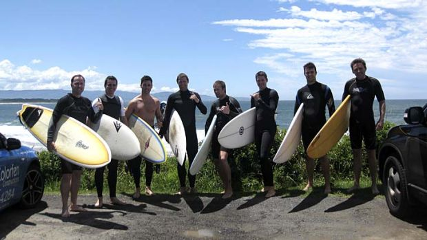 Swell times ... the annual boys-only surfing trip to Culburra Beach gets the thumbs up from this group of mates.