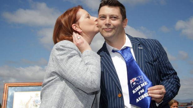 Prime Minister Julia Gillard gives new Australian citizen Ian Mears (previously from London) a kiss, at a citizenship ...