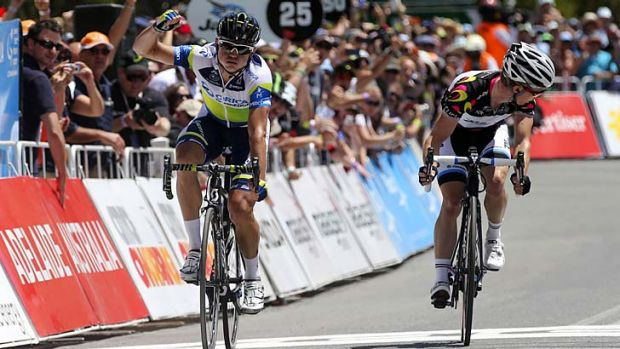 Local hero ... Simon Gerrans wins stage 5 of the Tour Down Under in Adelaide yesterday in front of Tom-Jelte Slagter, ...