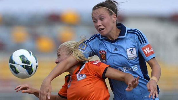 Getting it in the neck ... Caitlin Foord, of Sydney, right, and Tameka Butt, of Brisbane Roar, contest possession during ...