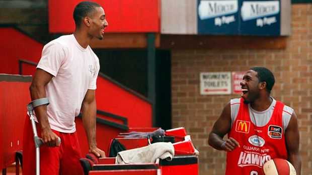 Reunited … injured guard Lance Hurdle and the Hawks' new signing Malcolm Grant.
