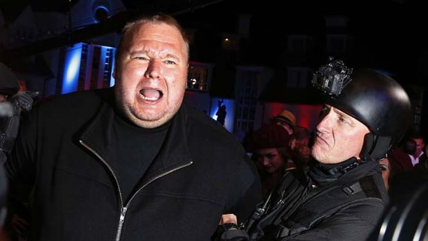 Always controversial … a mock arrest of Kim Dotcom during the launch of his new internet site, Mega, his successor ...