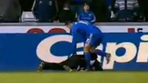 Chelsea player Eden Hazard pulls his foot back before kicking out at a ballboy.