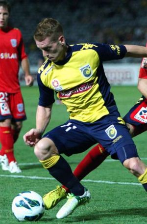 Excellence rewarded … Oliver Bozanic on the ball during the Mariners' 3-1 win over nearest rival Adelaide on ...
