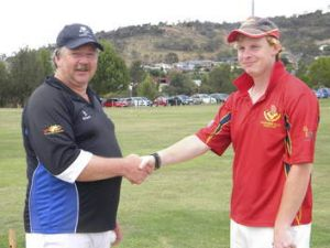 Peter Foley shakes hands with his 1000th victim Will Thomson.