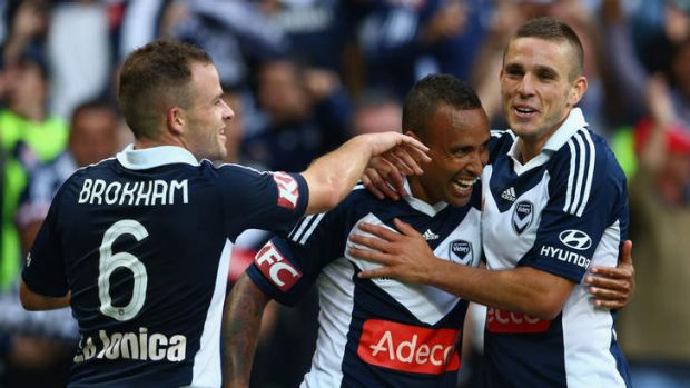 Victory is ours: Archie Thompson celebrates his goal with Leigh Broxham and Diogo Ferreira.
