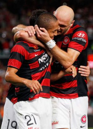 Shinji Ono of the Wanderers celebrates with team mate Dino Kresinger after scoring a penalty.