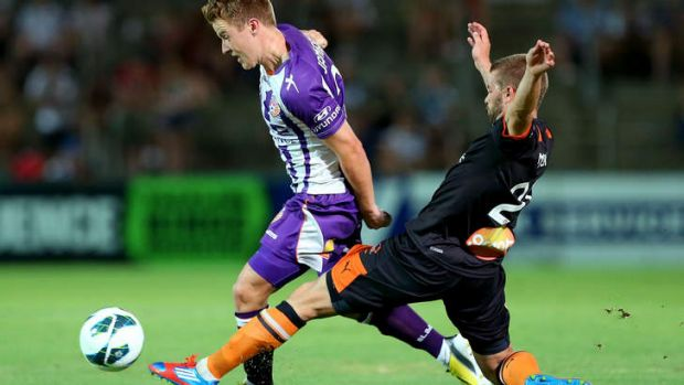 James Meyer of the Brisbane Roar tackles Scott Jamieson of Perth Glory during their round 18 A-League match at nib Stadium.