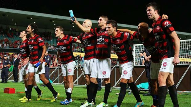 Winners ... Wanderers players celebrate with fans at full time.