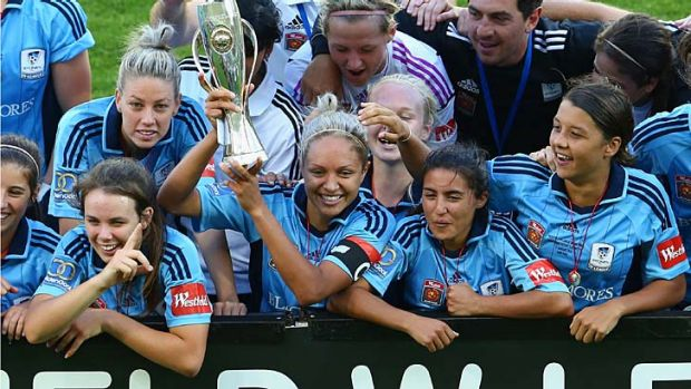 To the winners go the spoils ... Sydney FC celebrate their grand final win.