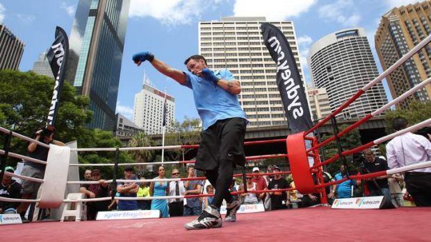 Daniel Geale working out in front of a crowd at Circular Quay.