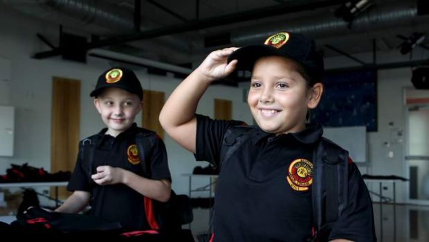 First in … Breanna Riley, left, and Brody Pyle try on their uniforms before starting school at the new Redfern ...