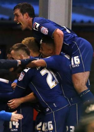 Jubilation ... Oldham Athletic players celebrate after scoring against Liverpool.