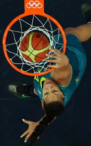 Above the rim … Liz Cambage, in action during the Olympics last year, has been impressive for Chinese side ...
