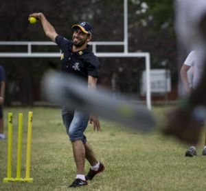 Fawad Ahmed at a cricket clinic for asylum seekers.