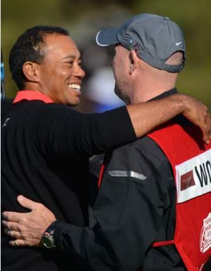 That's seven wins at Torrey ... Tiger Woods celebrates his victory with caddie Joe LaCava.