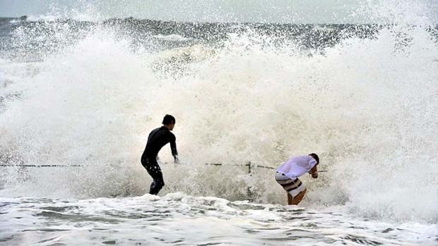 Teenagers brave the heavy surf at Collaroy Beach in Sydney's northern beaches.