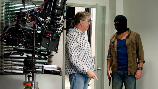 Director Kindall Rendall, left, on the set.