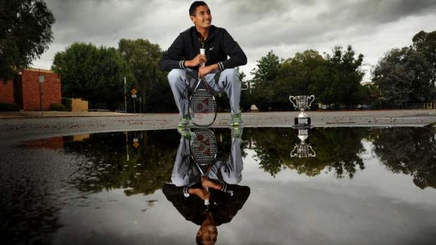 Australian Open Boys singles champion Nick Kyrgios back in Canberra today and showing off his trophy.