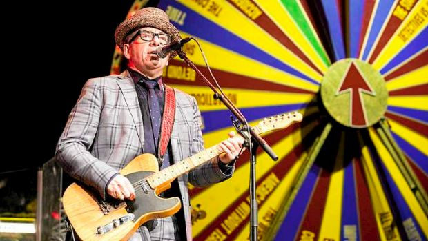 """Spin king: Elvis Costello and the Imposters, backed up by the """"Spectacular Spinning Songbook""""."""