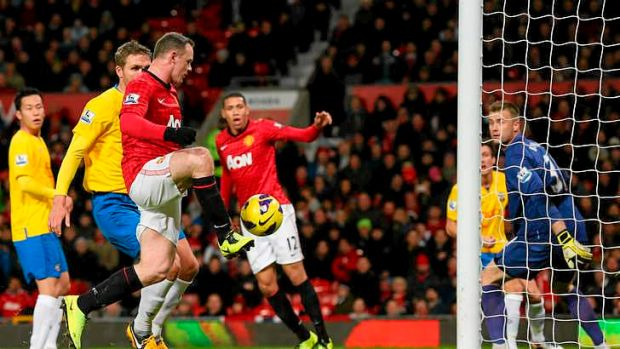 Manchester United's Wayne Rooney scores his team's second goal.