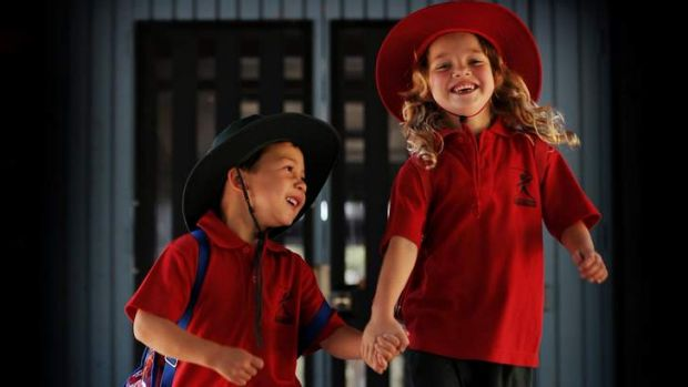 Five-year-olds   Matthew Ellwood, left,  and  Coco Gunther prepare for kindergarten at Macquarie Primary School.
