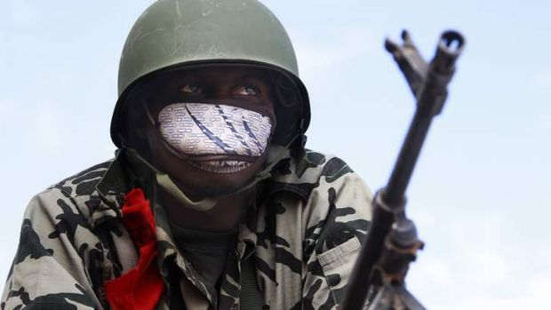 A Malian soldier stands guard.