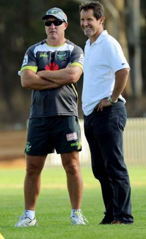 Sharing ideas … David Furner and Robbie Deans at Raiders training on Thursday.