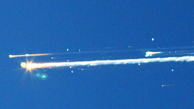 Debris from the space shuttle Columbia streaks across the sky over Tyler, Texas.