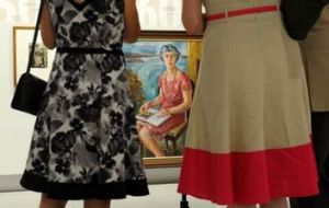 """Guests view the exhibition, """"First Ladies, Significant Australian Women 1913-2013""""."""