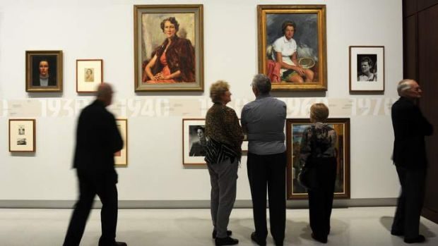 """Invited guests view the exhibition, """"First Ladies, Significant Australian Women 1913-2013"""" at the National Portrait Gallery."""