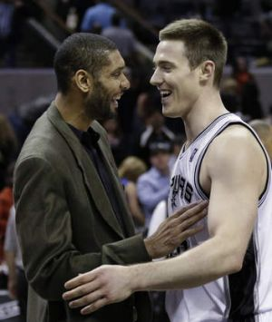 Aron Baynes is greeted by San Antonio superstar Tim Duncan.