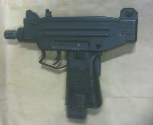 Fully loaded … the Uzi seized by police.