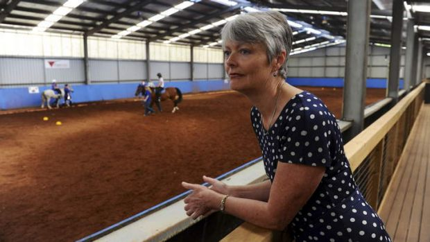 Margaret Morton, Executive Director of Pegasus, watches a riding for the disabled class at the complex in Holt.