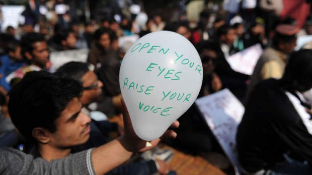 Open your eyes ... protesters in New Delhi.