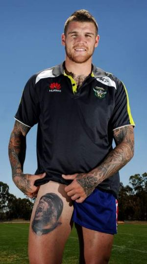 Raiders fullback Josh Dugan shows off his new tattoo, that of Baltimore Ravens NFL star Ray Lewis.