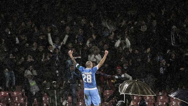 Napoli's captain Paolo Cannavaro celebrates after scoring against Catania.