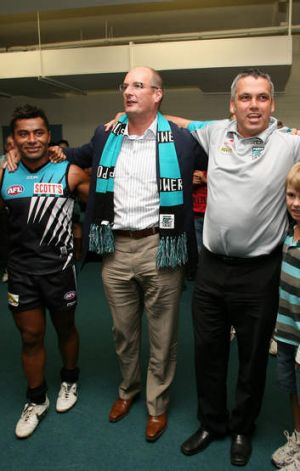 Port chief David Koch sings with the team back when he was the Power's No. 1 ticket holder.