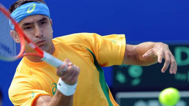 In charge: Marinko Matosevic won his reverse singles match against Taiwan.