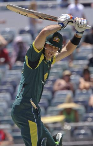 Glenn Maxwell watches his bails fly off.
